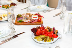 Salad and cold cuts on a banquet table Stock Photo