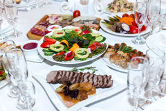 Salad and cold meats at the banquet table Royalty Free Stock Image