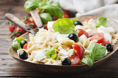 Salad with cold pasta and mozzarella. Selective focus Stock Photo