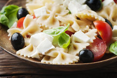 Salad with cold pasta and mozzarella. Selective focus Royalty Free Stock Image