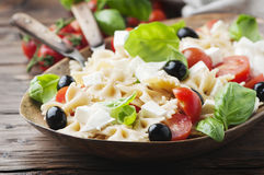 Salad with cold pasta and mozzarella. Selective focus Royalty Free Stock Photo