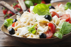 Salad with cold pasta and mozzarella. Selective focus Stock Images