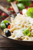 Salad with cold pasta and mozzarella. Selective focus Royalty Free Stock Photography