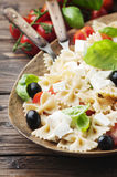 Salad with cold pasta and mozzarella and tomato. Selective focus Royalty Free Stock Photography