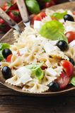 Salad with cold pasta and mozzarella and tomato. Selective focus Stock Images