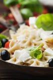 Salad with cold pasta and mozzarella and tomato Stock Image