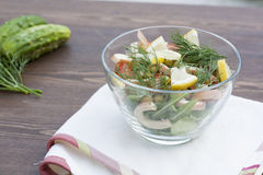 Salad of cooked squid, fresh vegetables and herbs Royalty Free Stock Photo