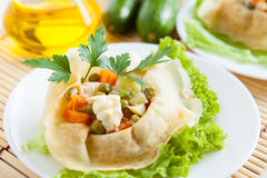 Salad with cooked vegetable wrapped in a pancake Royalty Free Stock Photos