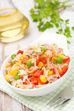 Salad with corn, green peas, rice, red pepper and tuna in a bowl Royalty Free Stock Image
