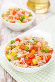 Salad with corn, green peas, rice, red pepper and tuna Stock Image