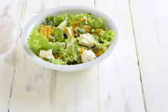 Salad with corn, greens, feta with mayonnaise sauce Royalty Free Stock Image