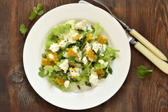 Salad with corn, greens, feta with mayonnaise sauce Royalty Free Stock Images