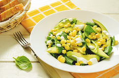 Salad with corn, spinach and avocado Stock Photo