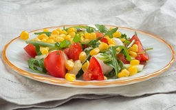 Salad with corn, tomato, arugula and mozzarella Royalty Free Stock Image