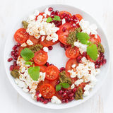 Salad with cottage cheese, tomatoes, mint pesto and pomegranate Stock Photography