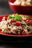 Salad couscous with tuna, bell pepper, cucumber, red onion and green beans Stock Photography