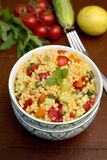 Salad with couscous and vegetables. Salad with couscous, sweet pepper, tomato, cucumber and mint Royalty Free Stock Photo