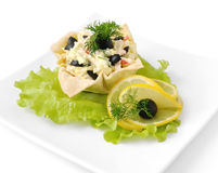 Salad with crab meat in a basket Stock Photo