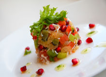 Salad with crab meat and fruits Stock Photos