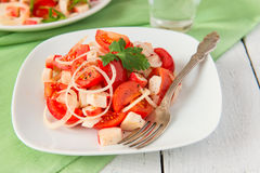 Salad with crab meat and tomatoes Royalty Free Stock Image