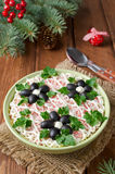 Salad with crab sticks, cheese, egg and prunes Stock Images