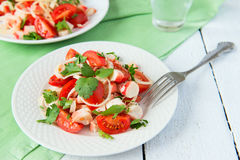 Salad from crabmeat sticks, tomatoes and parsley Stock Photography
