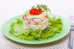 Salad of crabs with red caviar Royalty Free Stock Photos