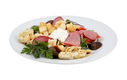 Salad with crackers, beef and mushrooms. On an isolated background Stock Image