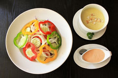 Salad and cream soup. Serving salad and cream soup Royalty Free Stock Image