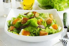 Salad with croutons,. Anchovies and eggs royalty free stock photography