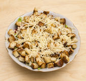 Salad with croutons, chicken, cheese and greens Royalty Free Stock Photos