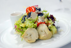 Salad with a crude and artichokes royalty free stock image