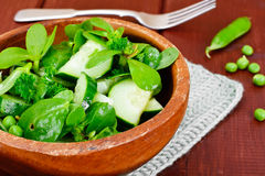 Salad with Cucumber, Purslane and Green Peas on Dark Disks Stock Photography