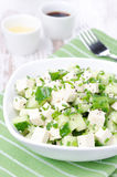 Salad with cucumber, tofu, chives and sesame seeds, vertical Royalty Free Stock Image
