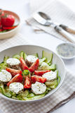 Salad with cucumber, tomatoes and goat cheese Stock Photos