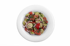 Salad cucumber tomatoes with walnuts traditional Georgian dish white background top view Stock Photography