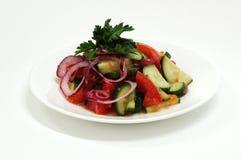 Salad with cucumber and tomatos. Salad with cucumber, onion and tomatos Stock Photos