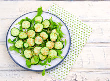 Salad from cucumbers with a linen seed Royalty Free Stock Photo