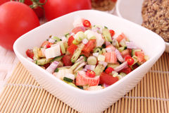 Salad of cucumbers with surimi Royalty Free Stock Photo
