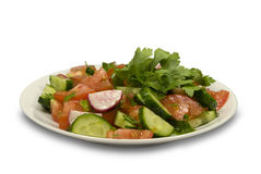 Salad with cucumbers and tomatoes. On a plate. On a white background Royalty Free Stock Photo