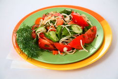 Salad with cucumbers, tomatoes and herbs Royalty Free Stock Photography