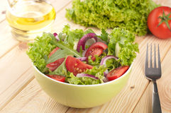 Salad with cucumbers tomatoes and onions Stock Images