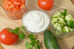 Salad with cucumbers, tomatoes and sour cream, mayonnaise. Royalty Free Stock Images