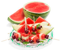 Salad with cut fruits on skewers, decorated with mint, on  glass Royalty Free Stock Photography