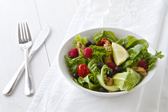 Salad with cutlery and linen Royalty Free Stock Images