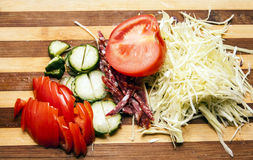 Salad cutting on a wooden board Royalty Free Stock Photography