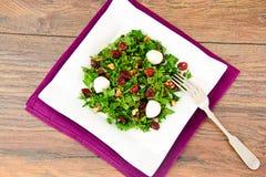 Salad with Dill, Parsley, Cilantro, Walnuts. And Dried Cherries Studio Photo Stock Photo