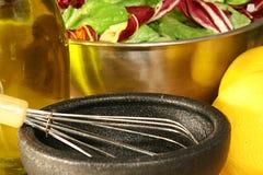 Salad & dressing. Salad bowl with olive oil & lemon Royalty Free Stock Images