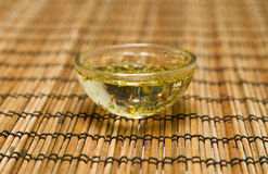 Salad dressing. With oil and herbs royalty free stock image