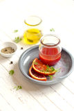 Salad dressing with olive oil and red orange juice Stock Photo